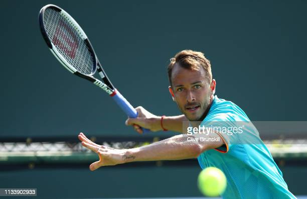 Lukas Rosol of the Czech Republic plays a forehand during his three set victory against Bernard Tomic of Australia in their second round qualifying...