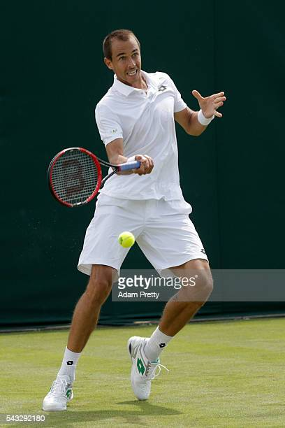 Lukas Rosol of The Czech republic plays a forehand shot during the Men's Singles first round match against Sam Querrey of The United States on day...