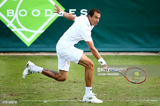 Lukas Rosol of the Czech Republic reaches for a backhand during his match against Kevin Anderson of South Africa during Day 1 of The Boodles Tennis...
