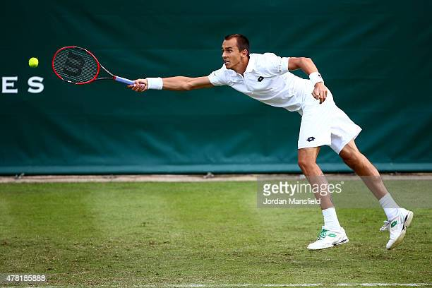Lukas Rosol of the Czech Republic reaches for a forehand during his match against Kevin Anderson of South Africa during Day 1 of The Boodles Tennis...