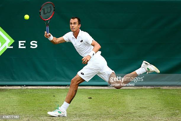 Lukas Rosol of the Czech Republic reaches for a forehand during his match against Nicolas Almagro of Spain during Day 2 of The Boodles Tennis Event...