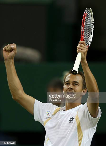 Lukas Rosol of the Czech Republic reacts after winning his Gentlemen's Singles second round match against Rafael Nadal of Spain on day four of the...