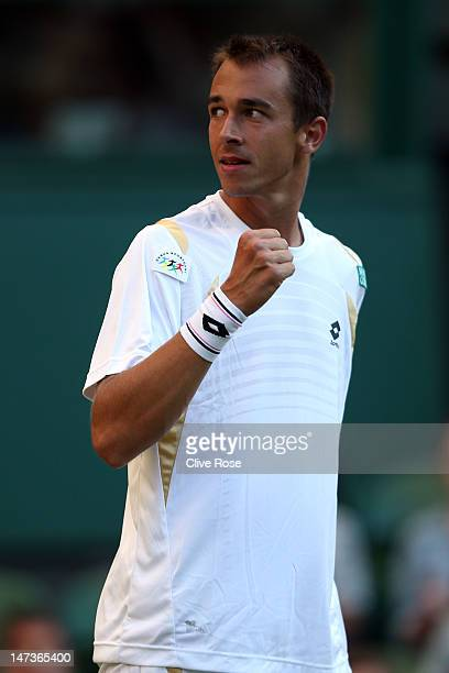 Lukas Rosol of the Czech Republic returns a shot during his Gentlemen's Singles second round match against Rafael Nadal of Spain on day four of the...