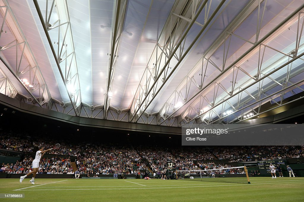 Lukas Rosol of the Czech Republic returns a shot during his Gentlemen's Singles second round match against Rafael Nadal of Spain on day four of the Wimbledon Lawn Tennis Championships at the All England Lawn Tennis and Croquet Club on June 28, 2012 in London, England.