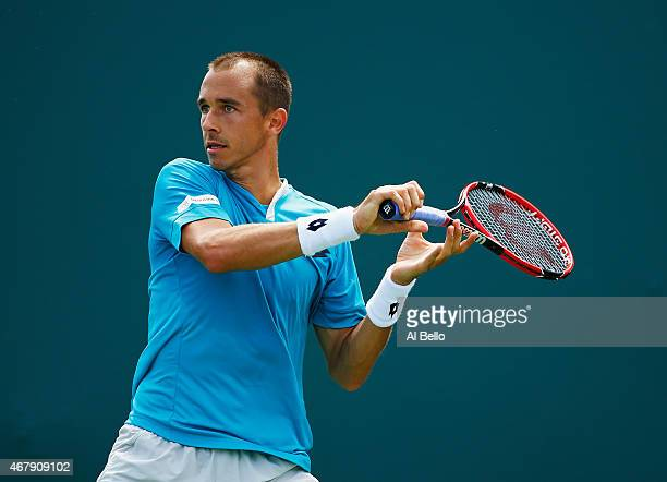 Lukas Rosol of the Czech Republic returns the ball against Alexander Zverev of Germany during day 6 of the Miami Open at Crandon Park Tennis Center...