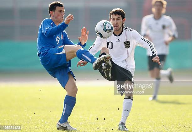 Lukas Rupp of Germany fights for the ball with Alessandro Florenzi of Italy during the men's U20 International friendly match between Germany and...