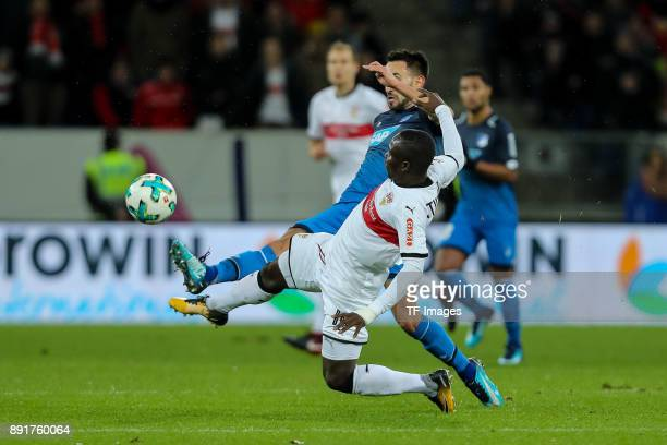 Lukas Rupp of Hoffenheim and Chadrac Akolo of Stuttgart battle for the ball during the Bundesliga match between TSG 1899 Hoffenheim and VfB Stuttgart...