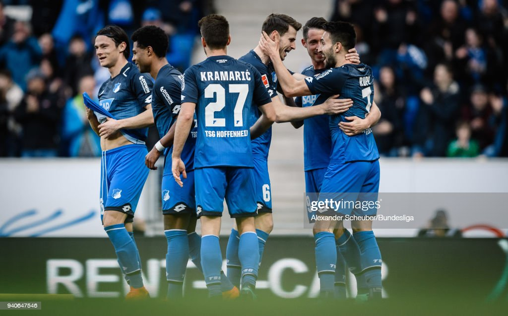 Lukas Rupp of Hoffenheim celebrates his goal with his teammates during the Bundesliga match between TSG 1899 Hoffenheim and 1. FC Koeln at Wirsol Rhein-Neckar-Arena on March 31, 2018 in Sinsheim, Germany.