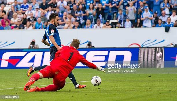 Lukas Rupp of Hoffenheim scores the second goal for his team against Ralf Faehrmann of Schalke during the Bundesliga match between TSG 1899...