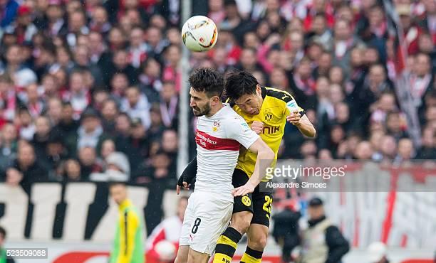 Lukas Rupp of VfB Stuttgart challenges Shinji Kagawa of Borussia Dortmund during the Bundesliga match between VfB Stuttgart v Borussia Dortmund at...