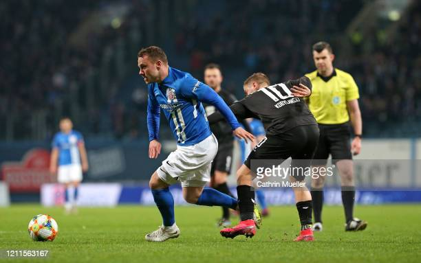 Lukas Scherff of Hansa Rostock and Martin Kobylanski of Eintracht Braunschweig battle for the ball during the 3 Liga match between Hansa Rostock and...