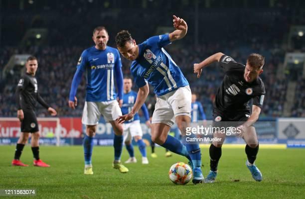 Lukas Scherff of Hansa Rostock and Patrick Kammerbauer of Eintracht Braunschweig during the 3 Liga match between Hansa Rostock and Eintracht...
