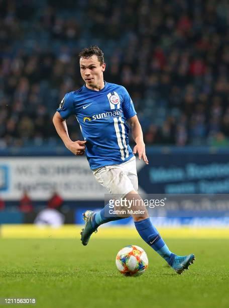 Lukas Scherff of Hansa Rostock runs with the ball during the 3 Liga match between Hansa Rostock and Eintracht Braunschweig at Ostseestadion on March...