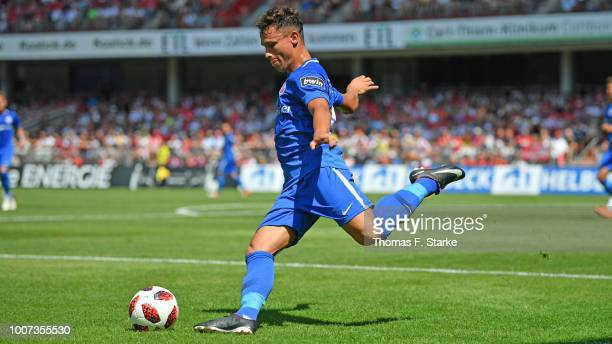 Lukas Scherff of Rostock kicks the ball during the 3. Liga match between FC Energie Cottbus and F.C. Hansa Rostock at Stadion der Freundschaft on...