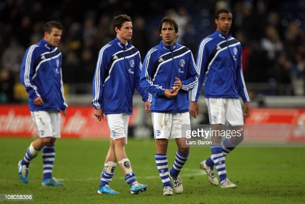 Lukas Schmitz Julian Draxler Raul Gonzales and Joel Matip are looking dejected after loosing the Bundesliga match between FC Schalke 04 and Hamburger...