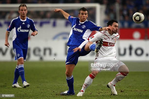Lukas Schmitz of Schalke and Timo Gebhart of Stuttgart battle for the ball during the Bundesliga match between FC Schalke 04 and VfB Stuttgart at the...
