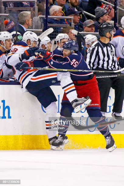 Lukas Sedlak of the Columbus Blue Jackets checks Anton Slepyshev of the Edmonton Oilers during the second period on December 12 2017 at Nationwide...