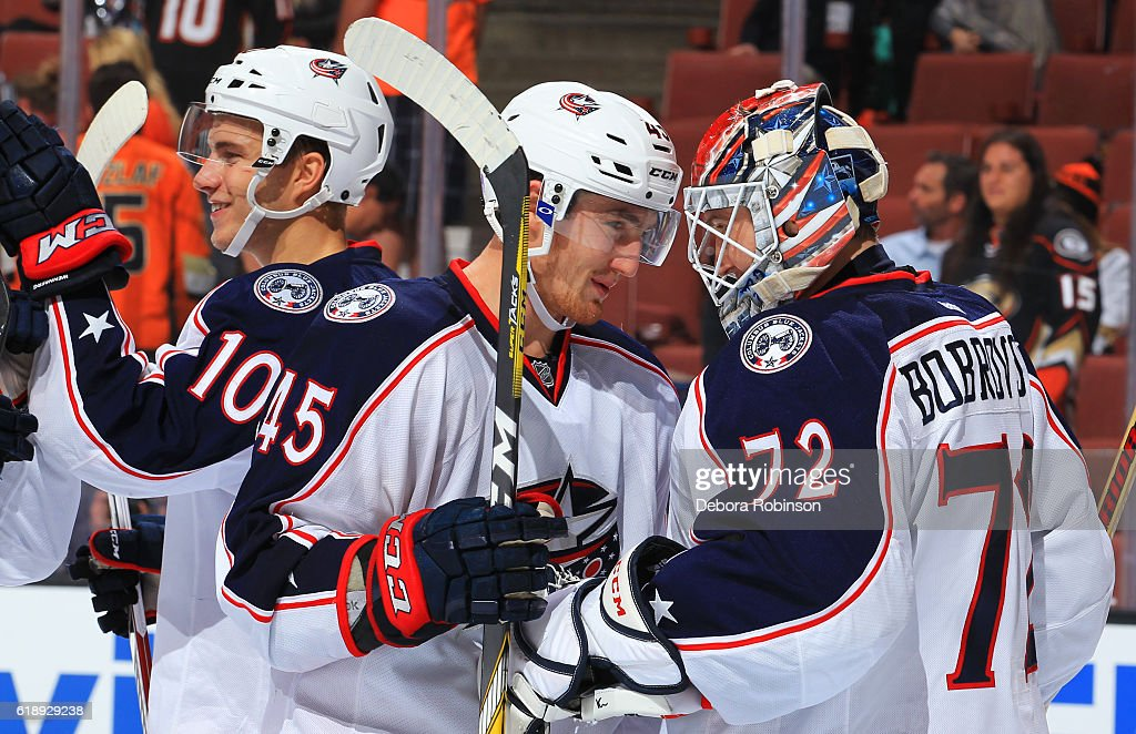 Lukas Sedlak #45, Sergei Bobrovsky #72, and Alexander Wennberg #10 of the Columbus Blue Jackets celebrate their win against the Anaheim Ducks on October 28, 2016 at Honda Center in Anaheim, California.