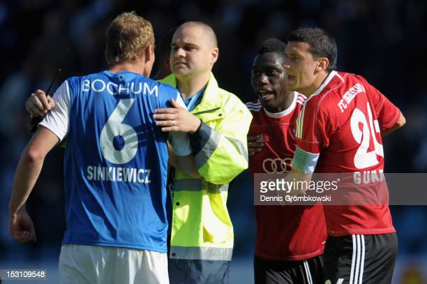 Lukas Sinkiewicz of Bochum and Danny da Costa of Ingolstadt argue after the Second Bundesliga match between VfL Bochum and FC Ingolstadt at...