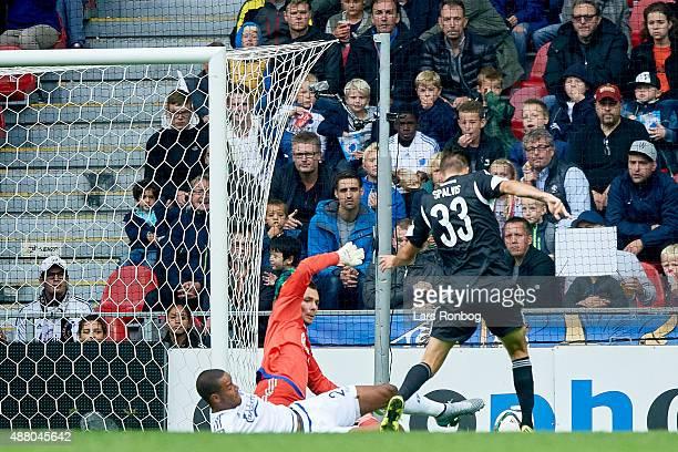 Lukas Spalvis of AaB Aalborg scores the 21 goal against Goalkeeper Stephan Andersen of FC Copenhagen during the Danish Alka Superliga match between...