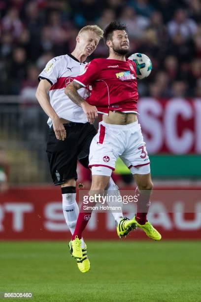 Lukas Spalvis of Kaiserslautern jumps for a header with Tim Baumgartl of Stuttgart during the DFB Cup match between 1 FC Kaiserslautern and VfB...