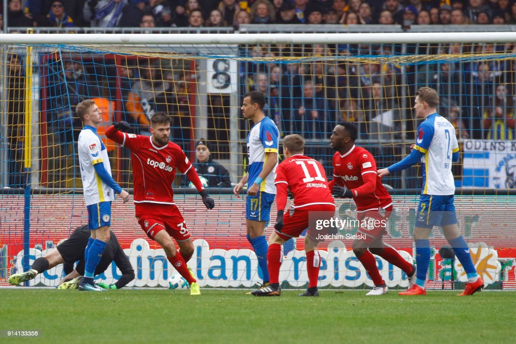Lukas Spalvis, Ruben Jenssen and Osayamen Osawe of Kaiserslautern celebration the Goal 0:1 during the Second Bundesliga match between Eintracht Braunschweig and 1. FC Kaiserslautern at Eintracht Stadion on February 4, 2018 in Braunschweig, Germany.