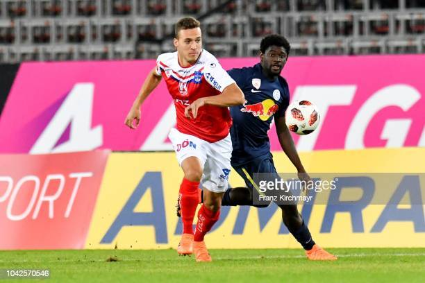 Lukas Tursch of FC Linz and Sekou Koita of Liefering compete for the ball during the 2 Liga match between FC Blau Weiss Linz v FC Liefering at TGW...