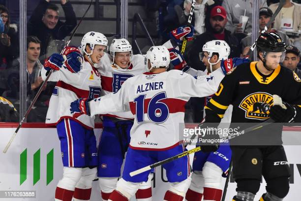 Lukas Vejdemo of the Laval Rocket celebrates his short handed goal with teammates against the Providence Bruins during the first period at Place Bell...