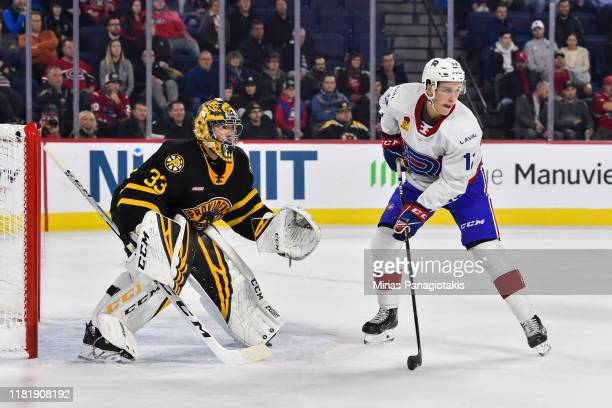 Lukas Vejdemo of the Laval Rocket gets into position near goaltender Maxime Lagace of the Providence Bruins at Place Bell on October 16 2019 in Laval...