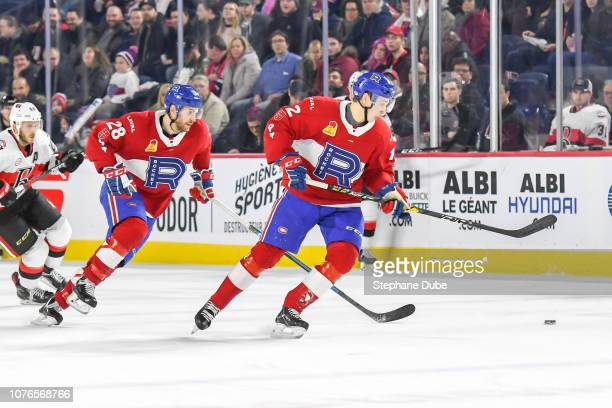 Lukas Vejdemo of the Laval Rocket is about to take the puck with Alexandre Grenier of the Laval Rocket close behind against the Belleville Senators...