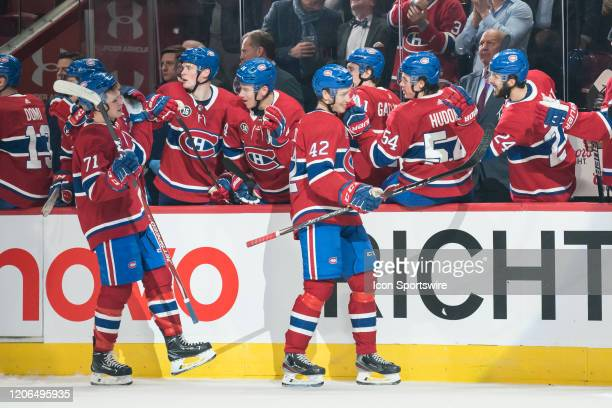 Lukas Vejdemo of the Montreal Canadiens celebrates with teammates at the bench after scoring his 1st NHL goal during the third period of the NHL game...