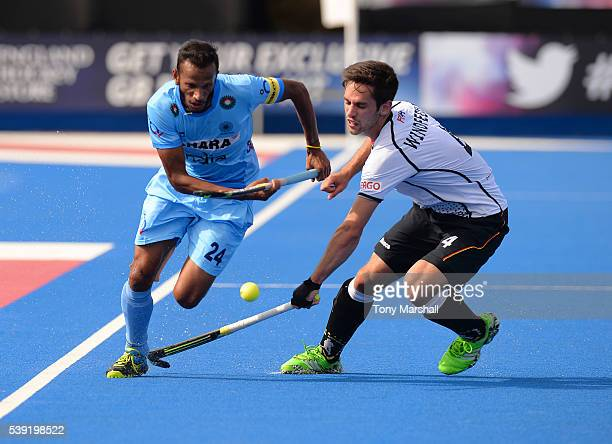 Lukas Windfeder of Germany tackles Sunil Sowmarpet of India during the FIH Men's Hero Hockey Champions Trophy 2016 Day One match between Germany and...