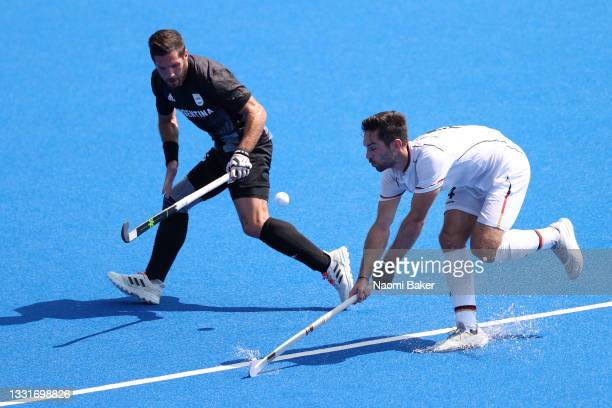 Lukas Windfeder of Team Germany chases the loose ball against Agustin Alejandro Mazzilli of Team Argentina during the Men's Quarterfinal match...