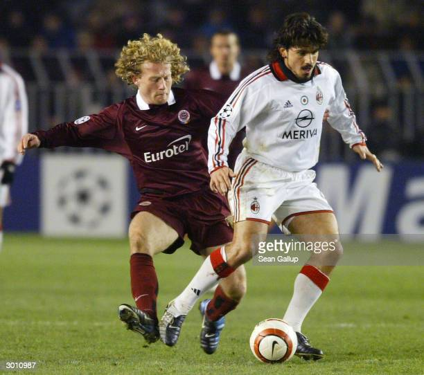 Lukas Zelenka of AC Sparta Prague and Gennaro Gattuso of AC Milan fight for the ball in their UEFA Champions League match February 24 2004 in Prague...