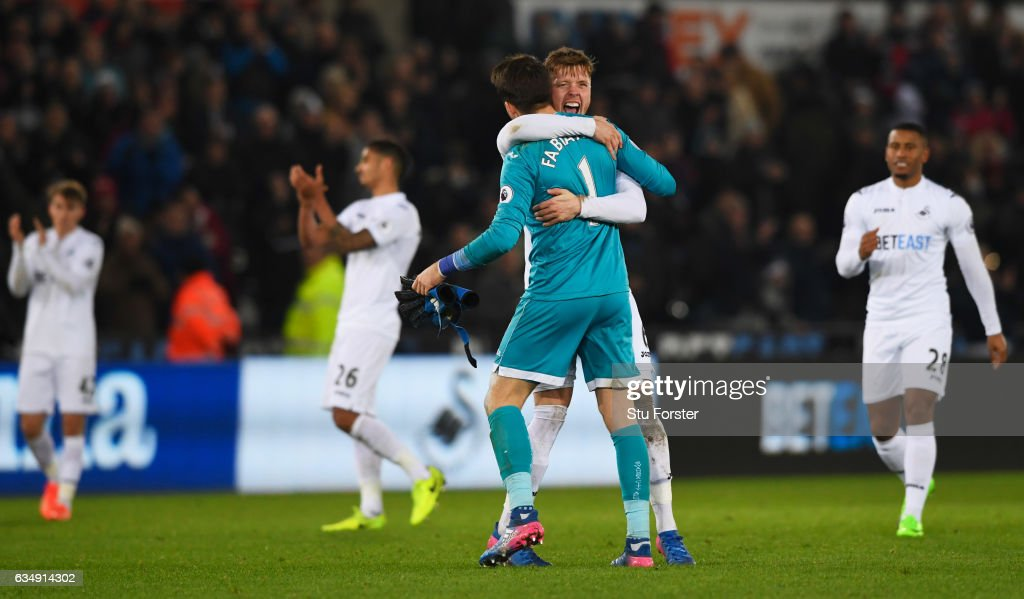 Lukasz Fabianski (1) and Alfie Mawson of Swansea City (6) celebrate victory with team mates during the Premier League match between Swansea City and Leicester City at Liberty Stadium on February 12, 2017 in Swansea, Wales.