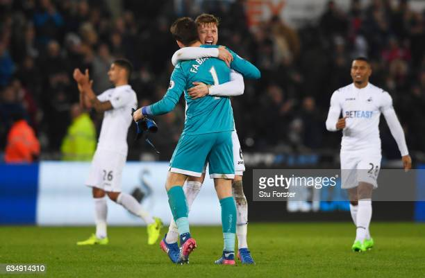 Lukasz Fabianski and Alfie Mawson of Swansea City celebrate victory with team mates during the Premier League match between Swansea City and...