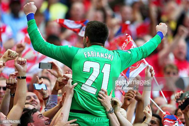 Lukasz Fabianski of Arsenal celebrates victory with fans after the FA Cup with Budweiser Final match between Arsenal and Hull City at Wembley Stadium...