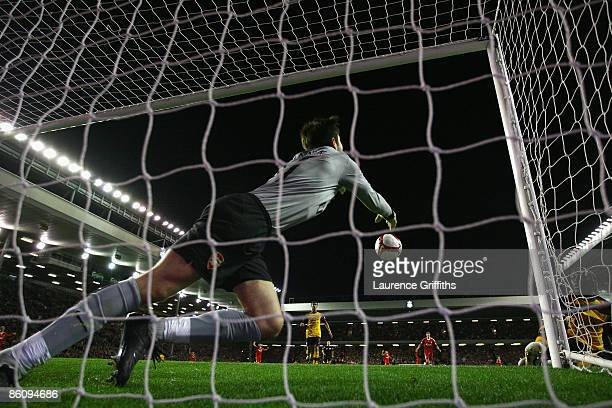 Lukasz Fabianski of Arsenal punches clear as Yossi Benayoun of Liverpool scores his team's second goal during the Barclays Premier League match...