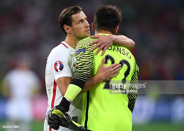 Lukasz Fabianski of Poland is consoled by his team mate Grzegorz Krychowiak after the UEFA EURO 2016 quarter final match between Poland and Portugal...