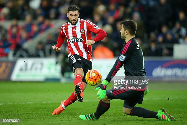 Lukasz Fabianski of Swansea City blocks a shot by Charlie Austin of Southampton during the Barclays Premier League match between Swansea City and...