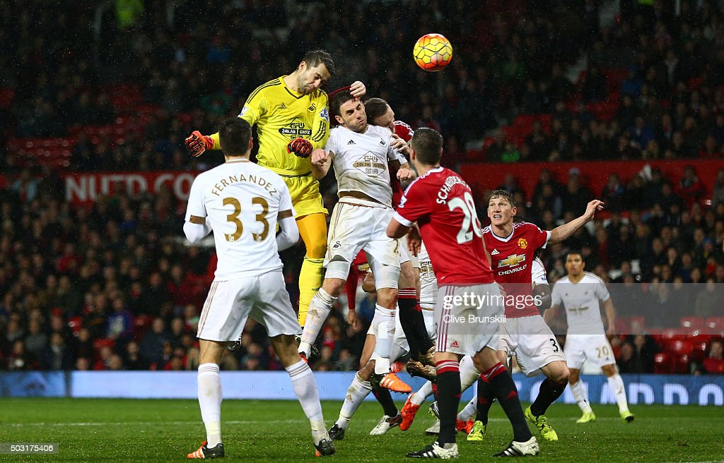 Lukasz Fabianski of Swansea City heads the ball during the Barclays Premier League match between Manchester United and Swansea City at Old Trafford on January 2, 2016 in Manchester, England.