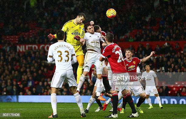 Lukasz Fabianski of Swansea City heads the ball during the Barclays Premier League match between Manchester United and Swansea City at Old Trafford...