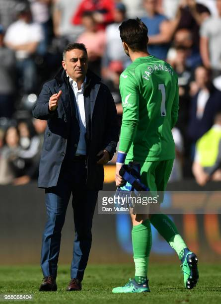 Lukasz Fabianski of Swansea City is embraced by Carlos Carvalhal Manaager of Swansea City after the Premier League match between Swansea City and...