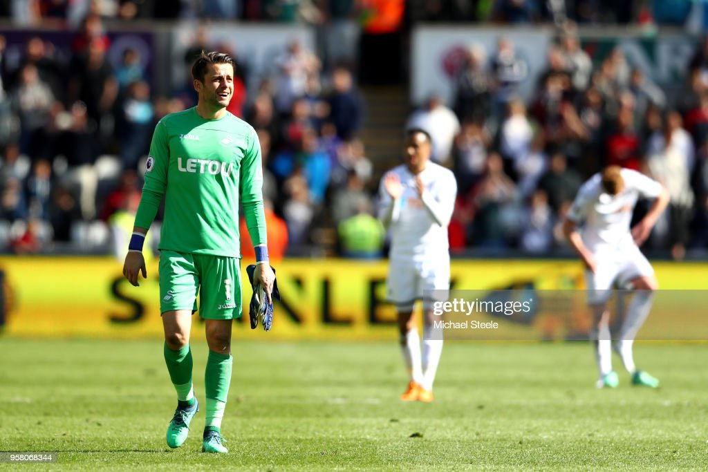 Lukasz Fabianski of Swansea City looks on after the final whistle after the Premier League match between Swansea City and Stoke City at Liberty Stadium on May 13, 2018 in Swansea, Wales.
