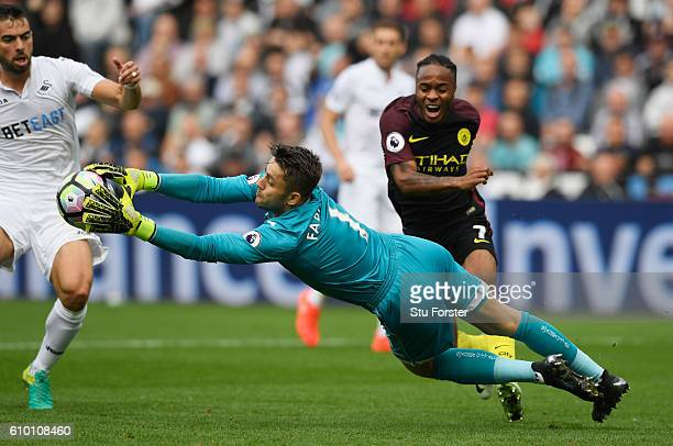 Lukasz Fabianski of Swansea City makes a save during the Premier League match between Swansea City and Manchester City at the Liberty Stadium on...
