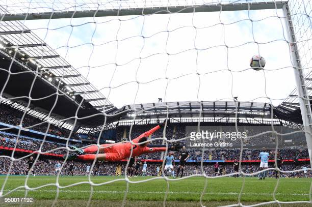 Lukasz Fabianski of Swansea City saves a penalty from Gabriel Jesus of Manchester City during the Premier League match between Manchester City and...