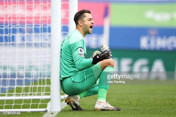 Lukasz Fabianski of West Ham celebrates the decision to disallow a goal scored by Harvey Barnes of Leicester City during the Premier League match...