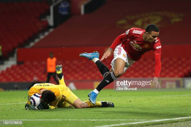 Lukasz Fabianski of West Ham United collects the ball whilst under pressure from Mason Greenwood of Manchester United during the Premier League match...
