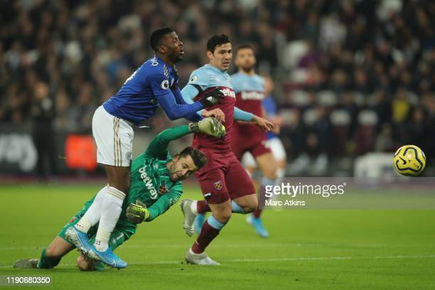 Lukasz Fabianski of West Ham United fouls Kelechi Iheanacho of Leicester City resulting in a penalty during the Premier League match between West Ham...