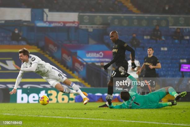 Lukasz Fabianski of West Ham United fouls Patrick Bamford of Leeds United leading to a penalty being awarded during the Premier League match between...